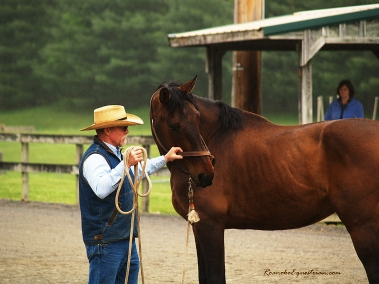 George Schaefer bends this horse's head, patiently waiting for the horse to move his hind end.