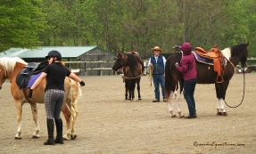George Schaefer gets his clinic participants ready to mount.