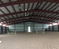 Ardmore's 100x200 lighted indoor arena allows for riding in all types of weather.