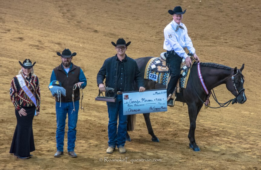 Horse and rider receiving winners check.